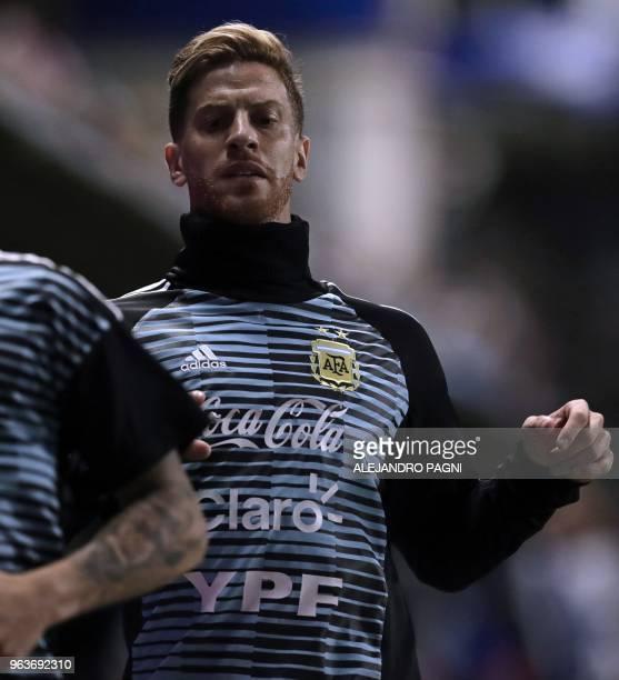 Argentina's Cristian Ansaldi warms up before the start of the international friendly football match against Haiti at Boca Juniors' stadium La...