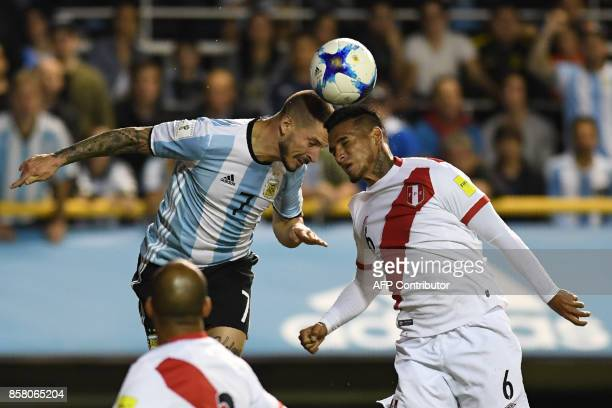 Argentina's Dario Benedetto and Peru's Miguel Trauco vie for the ball during their 2018 World Cup football qualifier match in Buenos Aires on October...
