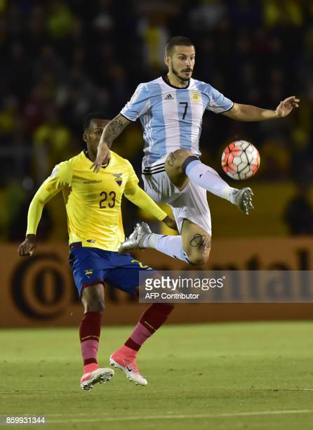 Argentina's Dario Benedetto jumps for the ball as Ecuador's Dario Aimar looks on during their 2018 World Cup qualifier football match in Quito on...
