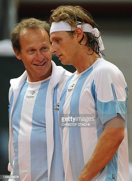 Argentina's David Nalbandian and Argentina's team captain Martin Jaite talk together during his match against German Florian Mayer at the quarter...