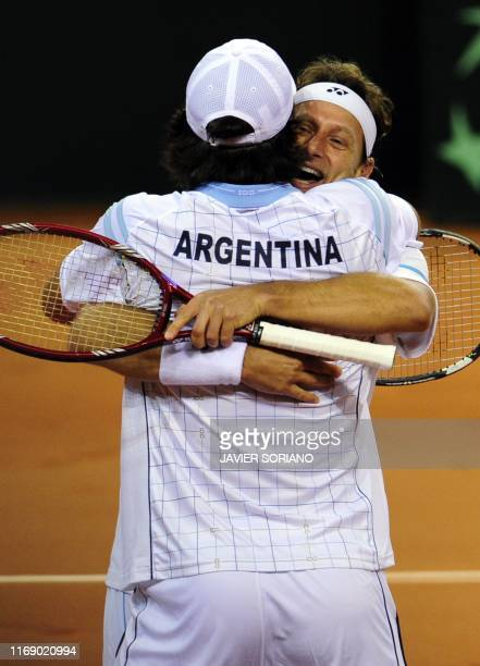 Argentina's David Nalbandian and teammate Eduardo Schwank celebrate after winning the Davis Cup final doubles match against Spain's Feliciano Lopez...