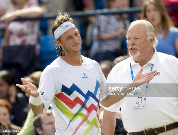 Argentina's David Nalbandian gestures after being disqualified for causing injury to a line judge during his mens singles final round match against...