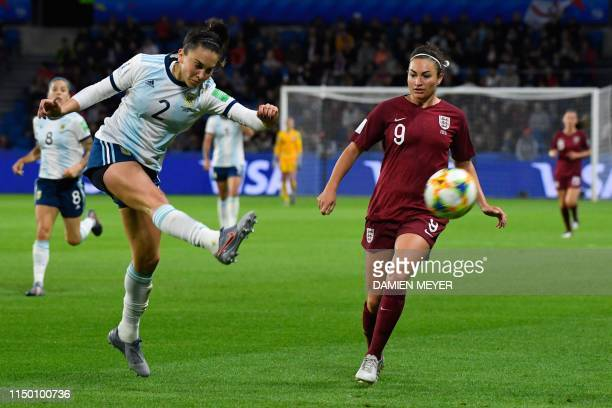 Argentina's defender Agustina Barroso vies for the ball with England's forward Jodie Taylor during the France 2019 Women's World Cup Group D football...