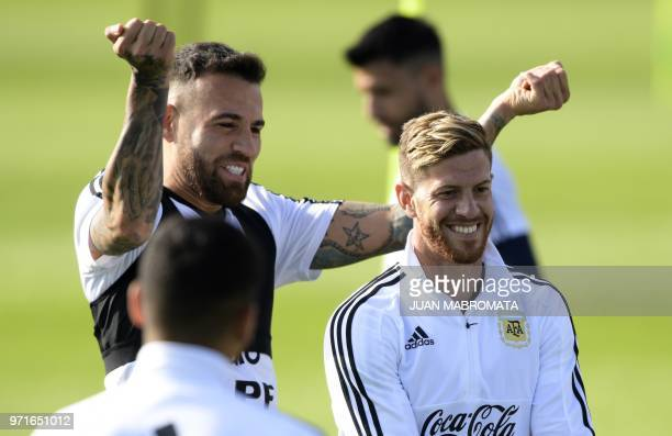 Argentina's defender Cristian Ansaldi and defender Nicolas Otamendi take part in a training session at the team's base camp in Bronnitsy near Moscow...
