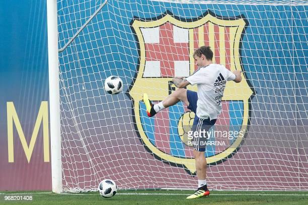 Argentina's defender Cristian Ansaldi attends a training session at the FC Barcelona 'Joan Gamper' sports center in Sant Joan Despi near Barcelona on...