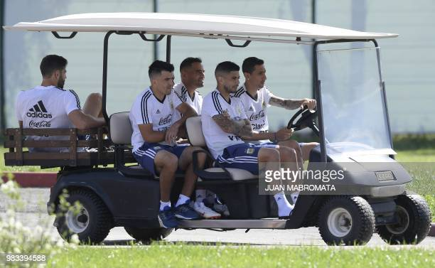 Argentina's defender Cristian Ansaldi defender Marcos Acuna defender Gabriel Mercado midfielder Ever Banega and midfielder Angel Di Maria arrive in a...