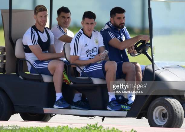 Argentina's defender Cristian Ansaldi defender Marcos Acuna midfielder Cristian Pavon and the team's press manager Nicolas Novello arrive for a...