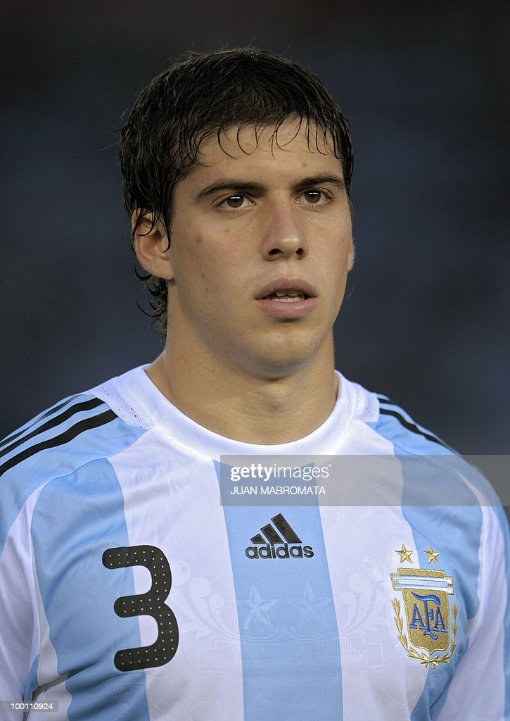 Argentina's defender Emiliano Insua looks on before the start of the FIFA World Cup South Africa-2010 qualifier football match against Peru at the Monumental stadium in Buenos Aires, Argentina on October 10, 2009. Argentina won 2-1. AFP PHOTO / Juan Mabromata