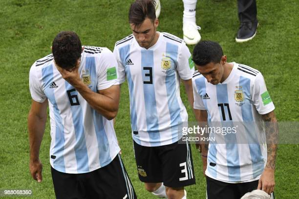 Argentina's defender Federico Fazio Argentina's defender Nicolas Tagliafico Argentina's forward Angel Di Maria react after losing the Russia 2018...