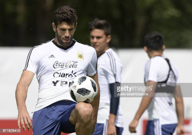 Argentina's defender Federico Fazio controls the ball during a training session at the team's base camp in Bronnitsy near Moscow on June 12 ahead of...