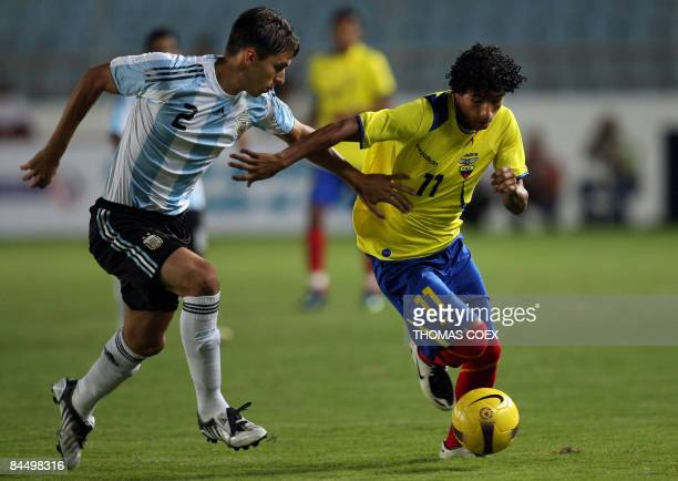 Argentina's defender Fernando Tobio vies for the ball with Ecuador's Joao Rojas Mendoza during their U20 South American football Championship match...