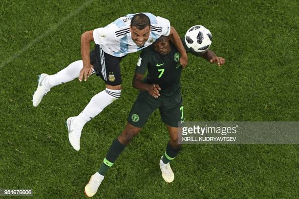 Argentina's defender Gabriel Mercado and Nigeria's forward Ahmed Musa compete for the ball during the Russia 2018 World Cup Group D football match...