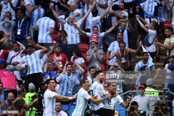 TOPSHOT Argentina's defender Gabriel Mercado celebrates with Argentina's forward Lionel Messi Argentina's forward Angel Di Maria and Argentina's...