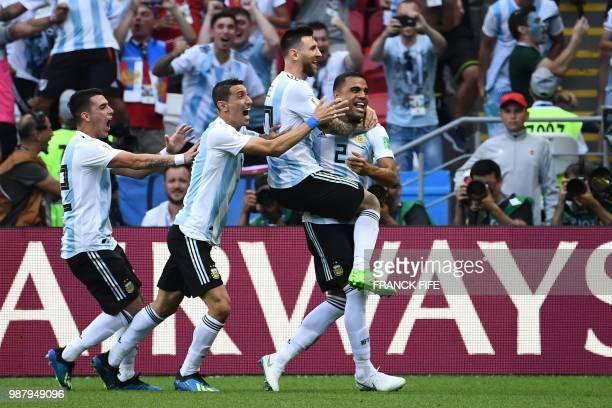 Argentina's defender Gabriel Mercado celebrates with Argentina's forward Lionel Messi Argentina's forward Angel Di Maria and Argentina's midfielder...