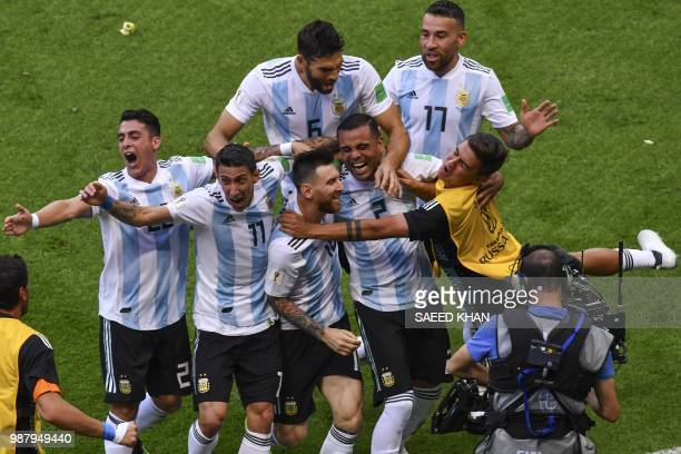 TOPSHOT Argentina's defender Gabriel Mercado celebrates with teammates after scoring his team's second goal during the Russia 2018 World Cup round of...