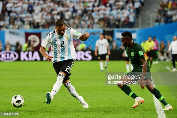 Argentina's defender Gabriel Mercado passes the ball ahead of Nigeria's forward Ahmed Musa during the Russia 2018 World Cup Group D football match...