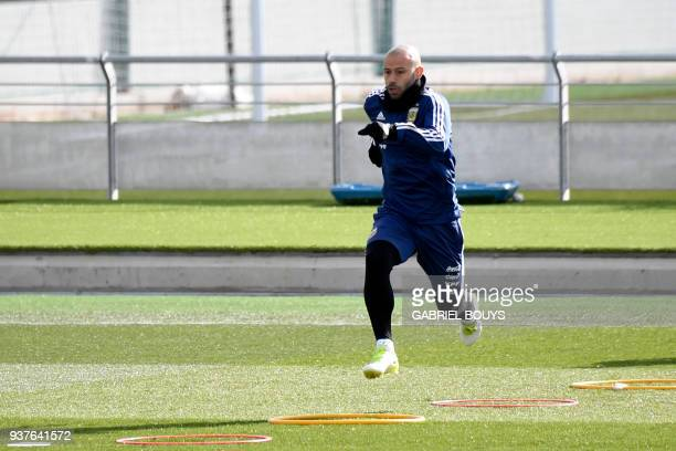 Argentina's defender Javier Mascherano runs during a training session in Madrid on March 25 2018 ahead of an international friendly football match...