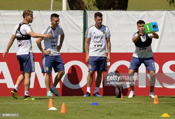 Argentina's defender Marcos Acuna defender Cristian Ansaldi midfielder Cristian Pavon and midfielder Giovani Lo Celso attend a training session at...