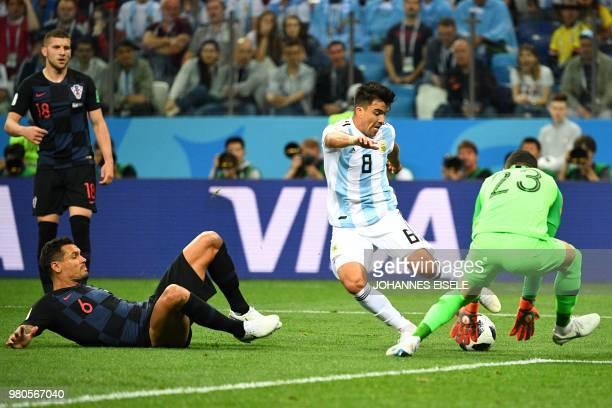 TOPSHOT Argentina's defender Marcos Acuna vies with Croatia's goalkeeper Danijel Subasic past Croatia's defender Dejan Lovren and Croatia's forward...
