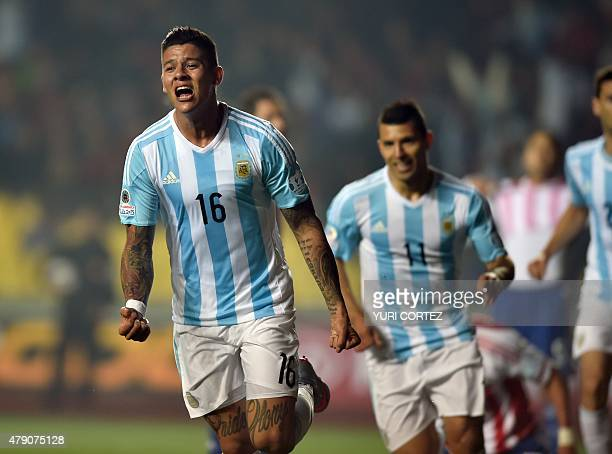 Argentina's defender Marcos Rojo celebrates after scoring against Paraguay during their Copa America semifinal football match in Concepcion, Chile on...