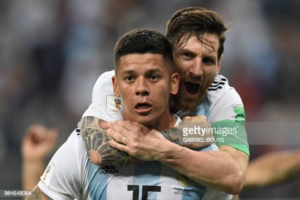 Argentina's defender Marcos Rojo celebrates his goal with Argentina's forward Lionel Messi during the Russia 2018 World Cup Group D football match...