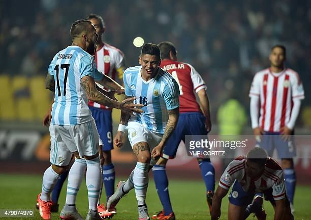 Argentina's defender Marcos Rojo celebrates with Argentina's defender Nicolas Otamendi after scoring against Paraguay during their Copa America...