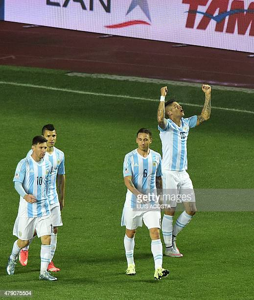 Argentina's defender Marcos Rojo celebrates with teammates after scoring against Paraguay during their Copa America semifinal football match in...