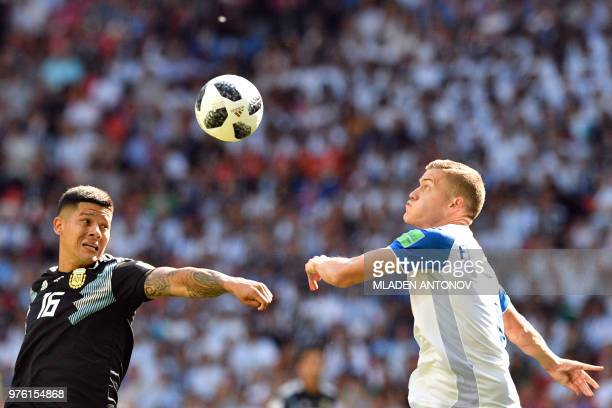 TOPSHOT Argentina's defender Marcos Rojo challenges Iceland's forward Alfred Finnbogason during the Russia 2018 World Cup Group D football match...