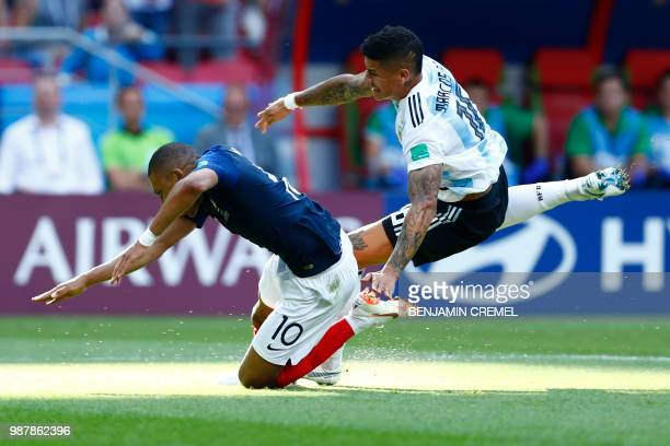 Argentina's defender Marcos Rojo fouls France's forward Kylian Mbappe in the penalty area during the Russia 2018 World Cup round of 16 football match...