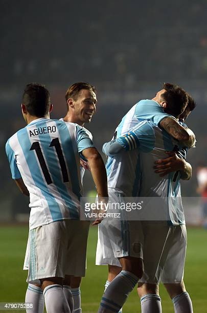 Argentina's defender Marcos Rojo kicks the ball to score against Paraguay during their Copa America semifinal football match in Concepcion, Chile on...