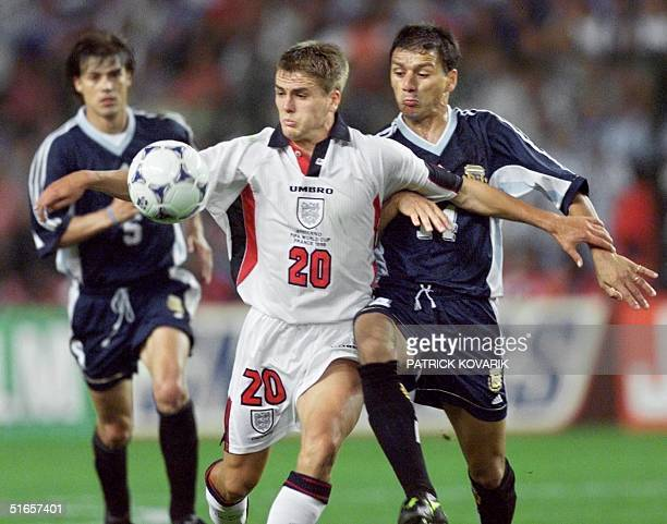 Argentina's defender Nelson Vivas challenges English forward Michael Owen during the 1998 Soccer World Cup second round match between Argentina and...