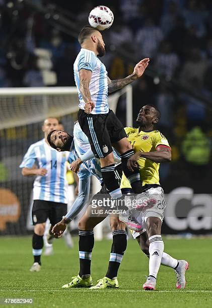 Argentina's defender Nicolas Otamendi collides with Colombia's forward Jackson Martinez and teammate Ezequiel Garay during their 2015 Copa America...