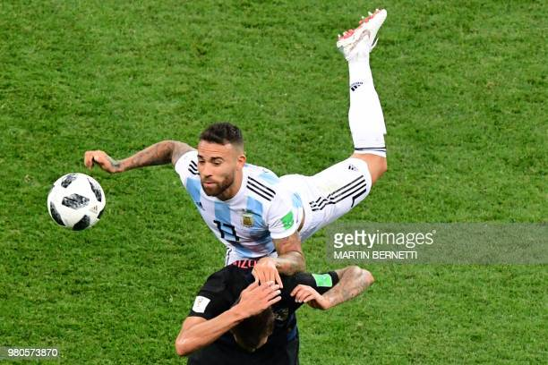Argentina's defender Nicolas Otamendi fights for the ball with Croatia's forward Mario Mandzukic during the Russia 2018 World Cup Group D football...
