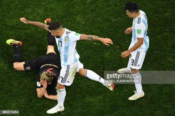 Argentina's defender Nicolas Otamendi makes a fault on Croatia's midfielder Ivan Rakitic during the Russia 2018 World Cup Group D football match...