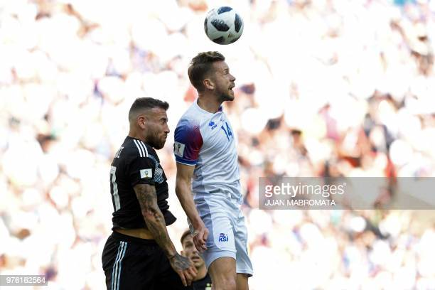 TOPSHOT Argentina's defender Nicolas Otamendi vies with Iceland's defender Kari Arnason during the Russia 2018 World Cup Group D football match...