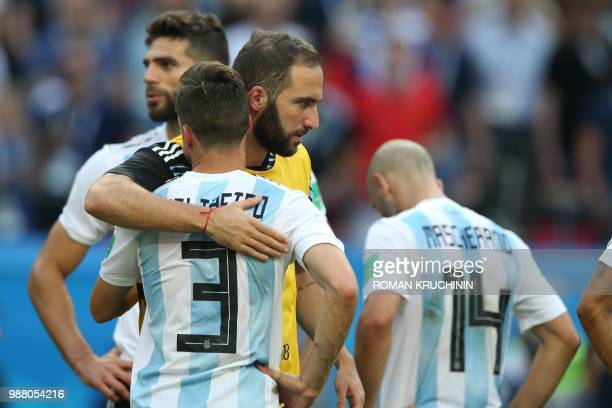 Argentina's defender Nicolas Tagliafico reacts with Argentina's forward Gonzalo Higuain after losing the Russia 2018 World Cup round of 16 football...