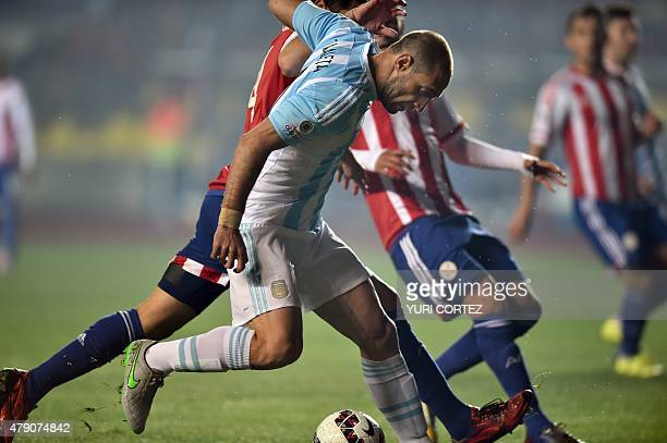 Argentina's defender Pablo Zabaleta vies for the ball with Paraguay's defender Pablo Cesar Aguilar during their Copa America semifinal football match...