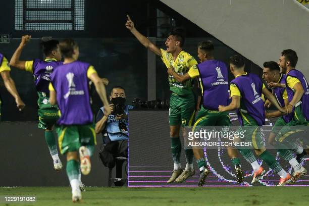 Argentina's Defensa y Justicia forward Braian Romero celebrates after scoring against Brazil's Santos during their closed-door Copa Libertadores...
