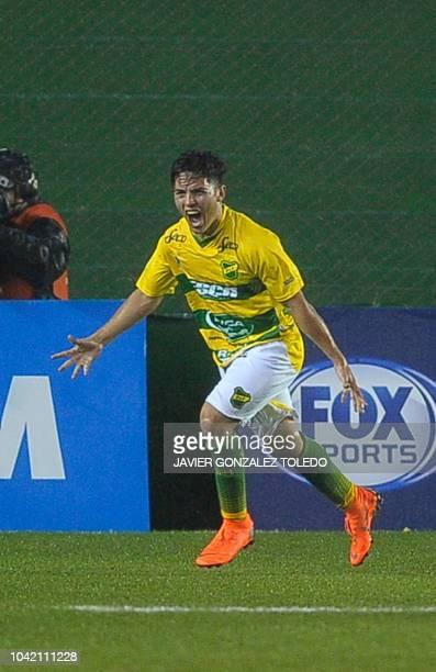 Argentina's Defensa y Justicia midfielder Ignacio Aliseda celebrates after scoring against Argentina's Banfield during their Copa Sudamericana round...