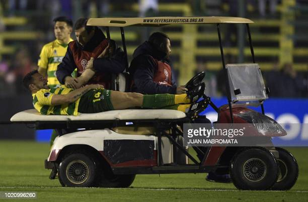 Argentina's Defensa y Justicia midfielder Jonas Gutierrez is taken out of the field after being injured during the Copa Sudamericana round of sixteen...
