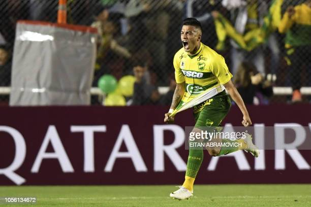 Argentina's Defensa y Justicia midfielder Leonel Miranda celebrates after scoring against Colombia's Atletico Junior during their Copa Sudamericana...