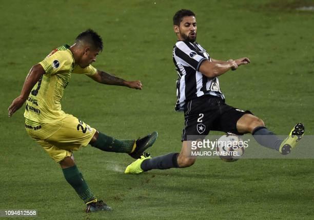 Argentina's Defensa y Justicia Nicolas Fernandez kicks the ball next to Brazil's Botafogo Gabriel during their Copa Sudamericana football match at...