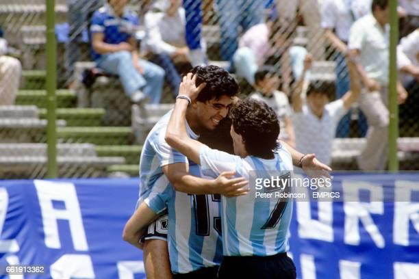 Argentina's Diego Maradona celebrates his goal with teammates Oscar Garre and Jorge Burruchaga