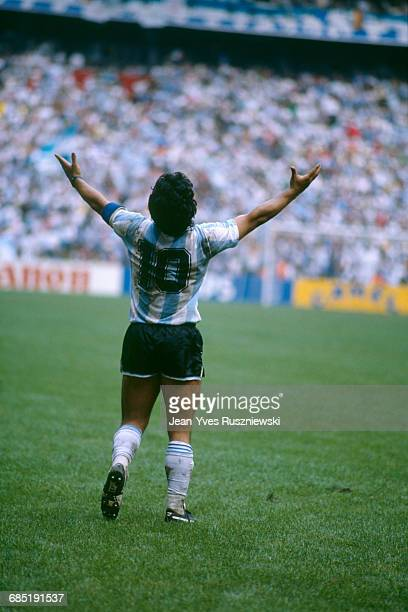 Argentina's Diego Maradona celebrates his team victory in their World Cup final match against Germany. Argentina defeated Germany 3-2.