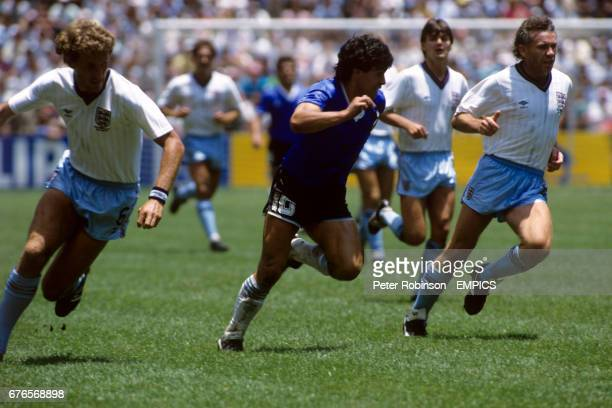 Argentina's Diego Maradona centre surrounded by England players left to right Terry Butcher Steve Hodge and Peter Reid
