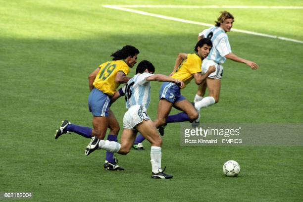 Argentina's Diego Maradona holds off a challenge from Brazil's Ricardo Rocha before playing the killer ball for teammate Claudio Caniggia to score...