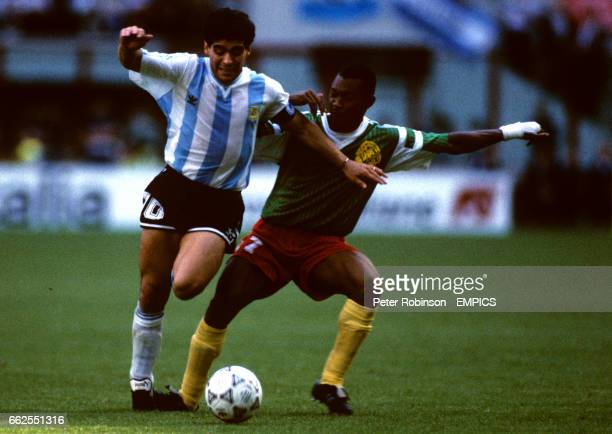 Argentina's Diego Maradona holds off Cameroon's Victor Ndip