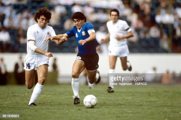 Argentina's Diego Maradona holds off Uruguay's Dario Pereira