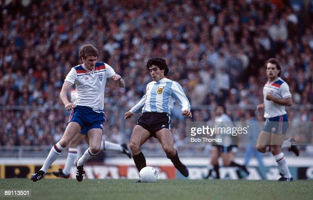 Argentina's Diego Maradona is challenged by England defender Phil Thompson during the International friendly match at Wembley Stadium 13th May 1980...