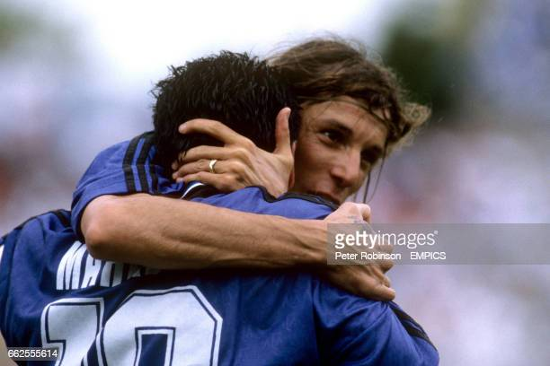 Argentina's Diego Maradona is congratulated by team mate Claudio Caniggia after scoring